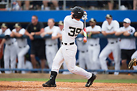Ben Breazeale (39) of the Wake Forest Demon Deacons follows through on his game winning 2-run home run in the bottom of the 11th inning against the Florida Gators in the completion of Game Two of the Gainesville Super Regional of the 2017 College World Series at Alfred McKethan Stadium at Perry Field on June 12, 2017 in Gainesville, Florida.  The Demon Deacons walked off the Gators 8-6 in 11 innings. (Brian Westerholt/Four Seam Images)
