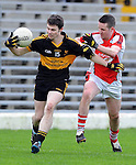 22-01-12:  Jamie Doolan, Dr Crokes, breaks away from Colm Kelly, Rathmore in the East Kerry O'Donoghue Cup final  in Fitzgerald Stadium, Killarney on Sunday. Picture: Eamonn Keogh ( MacMonagle, Killarney)