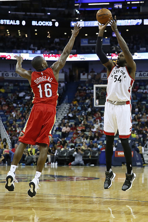 NEW ORLEANS, LA - MARCH 26: Patrick Patterson #54 of the Toronto Raptors shoots over Toney Douglas #16 of the New Orleans Pelicans during a game at the Smoothie King Center on March 26, 2016 in New Orleans, Louisiana. NOTE TO USER: User expressly acknowledges and agrees that, by downloading and or using this photograph, User is consenting to the terms and conditions of the Getty Images License Agreement.  (Photo by Jonathan Bachman/Getty Images)