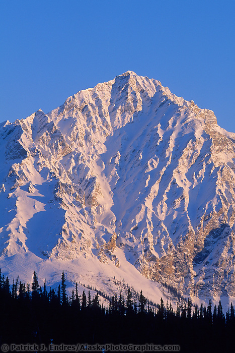 Late afternoon sunlight falls on the snow covered face of Mt. Dillon, Brooks Range, Arctic Alaska
