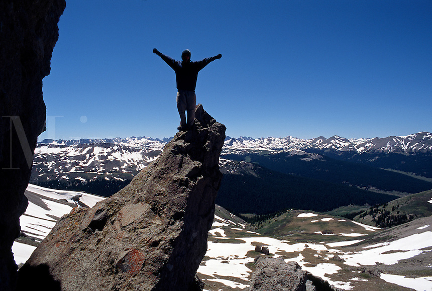 Triumphant hiker in the WINDOW at the CONTINENTAL DIVIDE - RIO GRANDE NTNL FRST - COLORADO ROCKIES