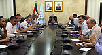 Palestinian Prime Minister Mohamad Ishtayeh meets with members of follow-up committee for popular resistance, at his headquarter in the West Bank city of Ramallah, June 1, 2019. Photo by Prime Minister Office