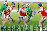 Lixnaws Shane McElligott been bottled up by Kenmare/Kilgarvan/Dr Crokes Jack Foley, Sean Casey and Richard O'Sullivan in the U21 County Hurling final in Austin Stack Park on Monday.