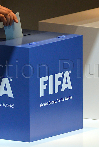 A representative of a national federation casts his vote into a ballot during the Extraordinary FIFA Congress 2016 held at the Hallenstadion in Zurich, Switzerland, 26 February 2016. The Extraordinary FIFA Congress is being held in order to vote on the proposals for amendments to the FIFA Statutes and choose the new FIFA President.