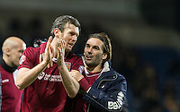 Zander Diamond (left) of Northampton Town and Ricky Holmes of Northampton Town celebrate the win during the Sky Bet League 2 match between Oxford United and Northampton Town at the Kassam Stadium, Oxford, England on 16 February 2016. Photo by Andy Rowland.