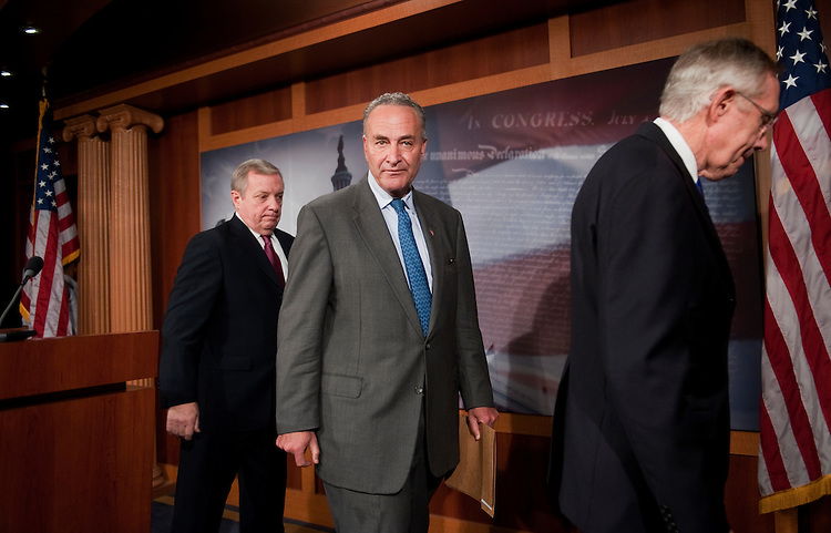 UNITED STATES - OCTOBER 05:  From left, Senate Majority Whip Richard Durbin, D-Ill., Sen. Charles Schumer, D-N.Y., and Senate Majority Leader Harry Reid, D-Nev., leave a news conference in the Capitol where they called on the Senate to pass the President Obama's $447 billion bill, The American Jobs Act, and to enact a new tax on millionaires to help pay for it.  (Photo By Tom Williams/Roll Call)