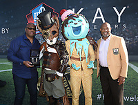 MIAMI BEACH, FL - JANUARY 30: FOX SUPER BOWL LIV ACTIVATION AT LUMMUS PARK AND FOX SPORTS SOUTH BEACH STUDIO: Mr. Fox and Ice Cream from The Masked Singer with Pro Football Hall of Fame members Charles Haley (L) and Dermontti Dawson (R) at FOX's weeklong interactive fan experience on the beach in Miami at Lummus Park on January 30, 2020 in Miami Beach, Florida. (Photo by Frank Micelotta/Fox/PictureGroup)
