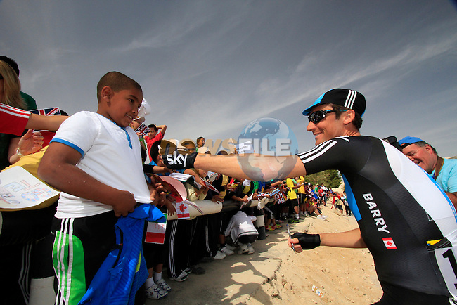 Sky Procycling team rider Michael Barry (CAN) signs autographs for local school children before the start of the 3rd Stage of the 2012 Tour of Qatar outside Dukhan Souq, Dukhan, Qatar, 7th February 2012 (Photo Eoin Clarke/Newsfile)