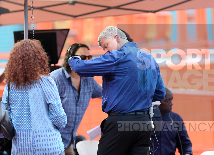 ITV's Adrian Chiles finds the going hot as he gets wiped down<br /> <br /> England vs Honduras  - International Friendly - Sun Life Stadium - Miami - USA - 07/06/2014  - Pic David Klein/Sportimage