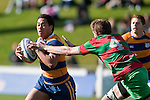 Daryl Sanft doesn't manage to evade the long reach of Tony Misa's tackle. Counties Manukau Premier Club Rugby final between Patumahoe & Waiuku played at Bayers Growers Stadium Pukekohe on Saturday August 8th 2009. Patumahoe won 11 - 9 after leading 11 - 6 at halftime.