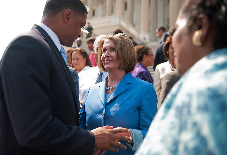 UNITED STATES - SEPTEMBER 14:  House Minority Leader Nancy Pelosi, D-Calif., speaks with Rep. Cedric Richmond after a rally on the House Steps with House Democrats to call on Republicans to take action on the American Jobs Act.  (Photo By Tom Williams/Roll Call)