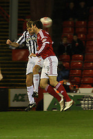 David van Zanten and Scott Vernon go for the high ball in the Aberdeen v St Mirren Scottish Communities League Cup match played at Pittodrie Stadium, Aberdeen on 30.10.12.