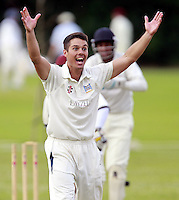 Will Russell of Highgate celebrates after taking the wicket of Hussain Shabbir during the Middlesex County Cricket League Division Three game between Highgate and North London at Park Road, Crouch End on Sat July 12, 2014