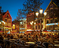 Niederlande, Nordholland, Amsterdam: Cafes am Leidesplein am Abend | Netherlands, North Holland, Amsterdam: Leidesplein cafes at night