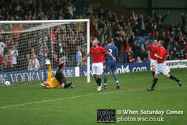 FC United of Manchester 8, Glossop North End 0, 28/10/2006. Gigg Lane, Bury, North West Counties League division one. Jamie Phoenix celebrating scoring as his team FC United of Manchester take on Glossop North End (blue shirts) in a North West Counties division one match at United's home stadium, Gigg Lane, home to Bury FC. The match was staged on People United Day, an event started in 1999 which brought together fans from across Europe to campaign against racism. FC United were formed in the summer of 2005 by supporters of Manchester United in response to the take over of their club by American millionaire Malcolm Glazer and his family. The club entered the football pyramid at the lowest level with the intention to climbing through the leagues. FCUM won the match 8-0, watched by 3257 spectators. Photo by Colin McPherson.