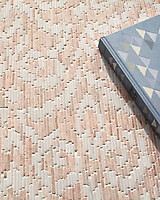 Indira, a hand-cut tumbled mosaic, shown in Desert Pink and Calacatta Tia , is part of the Tissé® collection for New Ravenna.