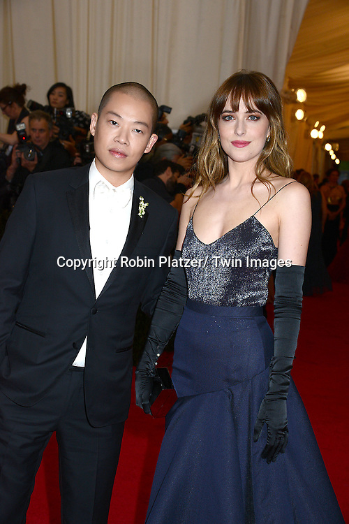 Jason Wu and Dakota Johnson  attends the Costume Institute Benefit on May 5, 2014 at the Metropolitan Museum of Art in New York City, NY, USA. The gala celebrated the opening of Charles James: Beyond Fashion and the new Anna Wintour Costume Center.