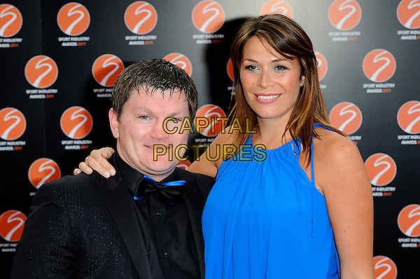 RICKY HATTON & JENNIFER DOOLEY .Attending the Sport Industry Awards, .Battersea Evolution, London, England, UK, May 12th 2011..arrivals half length black bow tie shirt blue tuxedo tux blue the hitman couple .CAP/CJ.©Chris Joseph/Capital Pictures.