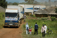 UN's World Food Programme arrives at one of many northern Uganda camps for Internally displaced people inear Gulu, Uganda. The WFP delivers cooking oil, 50-Kilo bags of cornmeal and other grains in a monthly allotment. More than two million people had fled their homes in the north, fleeing attacks by the Lords Resistance Army over the course o the 20-year conflict. The LRA has fled to The emocratic Republic of Congo enabling many northern residents to return to their homes.