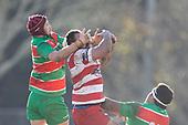 Michael McKee and Raymond Fuilala-Alesana compete for a high ball. Counties Manukau Premier Club Rugby game between Karaka and Waiuku, played at Karaka Sports Park on Saturday June 9th 2018. Karaka won the game 22 - 18 after trailing 5 - 13 at halftime.  Photo by Richard Spranger.