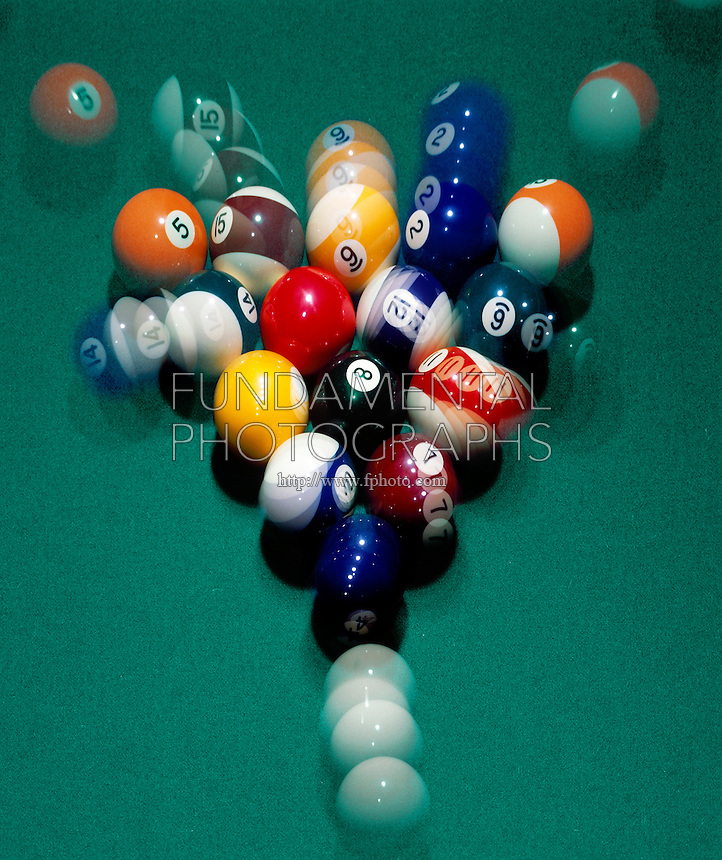 TRANSFER OF ENERGY - BILLIARD BALL BREAK <br /> Cue ball strikes target ball &amp; transfers all its energy to forward momentum of target ball and into pool ball rack.