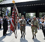 August 15, 2011, Tokyo, Japan - Members of a private group in old imperial army battle gear complete with a dummy officers sword and a bolt-action rifle presents the colors at Yasukuni Shrine in Tokyo as visitors pay their homage to the war dead as the nation observes the 66th anniversary of the end of World War II on Monday, August 15, 2011. (Photo by AFLO) [3620] -mis-