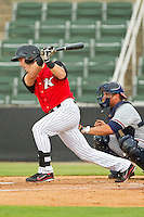 Chris Curley (11) of the Kannapolis Intimidators follows through on his swing against the Rome Braves at CMC-Northeast Stadium on August 5, 2012 in Kannapolis, North Carolina.  The Intimidators defeated the Braves 9-1.  (Brian Westerholt/Four Seam Images)