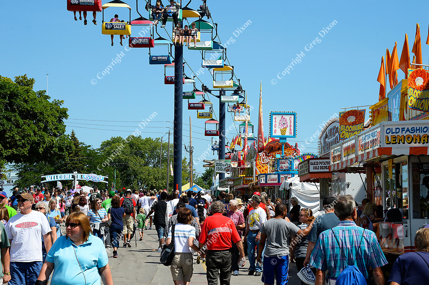 People enjoy Wisconsin food and rides at the 2015 Wisconsin State Fair on Thursday, August 6, 2015 in West Allis, Wisconsin