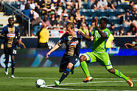 Brian Carroll (7) of the Philadelphia Union and Eddie Johnson (7) of the Seattle Sounders. The Philadelphia Union and the Seattle Sounders played to a 2-2 tie during a Major League Soccer (MLS) match at PPL Park in Chester, PA, on May 4, 2013.