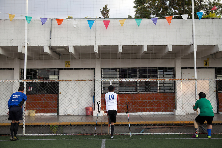 """Player from Guerreros Aztecas during a training in Mexico City, Mexico on June 12, 2014. Victor lost his left leg after an assault in 2011. He is currently unemployed and he wants to be a DJ. Guerreros Aztecas (""""Aztec Warriors"""") is Mexico City's first amputee football team. Founded in July 2013 by five volunteers, they now have 23 players, seven of them have made the national team's shortlist to represent Mexico at this year's Amputee Soccer World Cup in Sinaloathis December.The team trains twice a week for weekend games with other teams. No prostheses are used, so field players missing a lower extremity can only play using crutches. Those missing an upper extremity play as goalkeepers. The teams play six per side with unlimited substitutions. Each half lasts 25 minutes. The causes of the amputations range from accidents to medical interventions – none of which have stopped the Guerreros Aztecas from continuing to play. The players' age, backgrounds and professions cover the full sweep of Mexican society, and they are united by the will to keep their heads held high in a country where discrimination against the disabled remains widespread.(Photo byBénédicte Desrus)"""