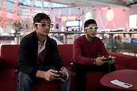 Young men play 3D video games in the Family Mall in Erbil, a Turkish built and owned project. one of the numerous new malls that have been built in the city over the past years.