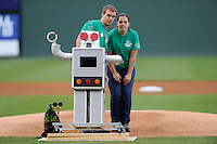 High school students prepare to have their robot throw out the first pitch before a game between the Greenville Drive and Lexington Legends on Monday, August 19, 2013, at Fluor Field at the West End in Greenville, South Carolina. (Tom Priddy/Four Seam Images)