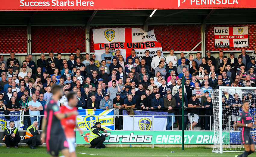 Leeds United fans watch on<br /> <br /> Photographer Alex Dodd/CameraSport<br /> <br /> The Carabao Cup First Round - Salford City v Leeds United - Tuesday 13th August 2019 - Moor Lane - Salford<br />  <br /> World Copyright © 2019 CameraSport. All rights reserved. 43 Linden Ave. Countesthorpe. Leicester. England. LE8 5PG - Tel: +44 (0) 116 277 4147 - admin@camerasport.com - www.camerasport.com