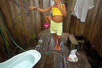 Belém,Brazil : 27/03/2002 - A young girl at the outskirts of Belém where there is no basic sanitationl. .