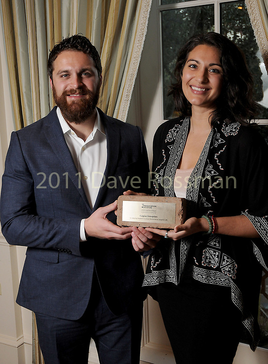 """Winners Andre and Natasha Azizi from Caspian Enterprises' at Preservation Houston's """"The Cornerstone Dinner""""  presenting the 2018 Good Brick Awards at the River Oaks Country Club Friday March 02,2018. (Dave Rossman Photo)"""
