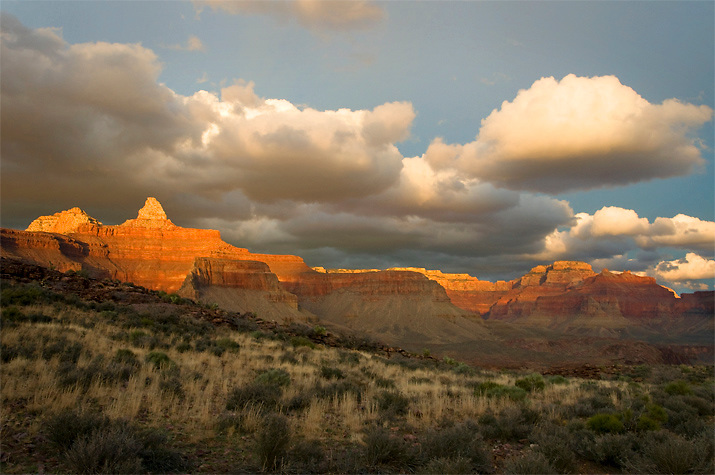 A dramatic winter storm clears as the sunset lights up Zoroaster Temple in Grand Canyon National Park