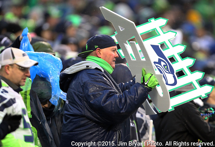 Seattle Seahawks fans cheer on the offense in their game against the St. Louis Rams at CenturyLink Field in Seattle, Washington on December 27, 2015.  The Rams beat the Seahawks 23-17.      ©2015. Jim Bryant Photo. All Rights Reserved