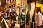 People lined up at the entrance to Sayers Club nightclub, through Papaya King restaurant in Hollywood, Los Angeles, CA