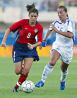 August 11th, 2004:  Mia Hamm dribbles the ball away from Greece Defender at Pankritio Stadium in Heraklio, Greece.   Hamm scored a goal and USA defeated Greece, 3-1.  .Credit: Michael Pimentel / ISI