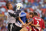Aug 22 2007:  Jon Busch (1) goalie for the Fire pulls down a cross in the box as he collides with Jimmy Conrad (12) of the Wizards, with C.J. Brown (2) of the Fire helping to defend.  The MLS Kansas City Wizards defeated the visiting Chicago Fire 3-2 at Arrowhead Stadium in Kansas City, Missouri, in a regular season league soccer match.