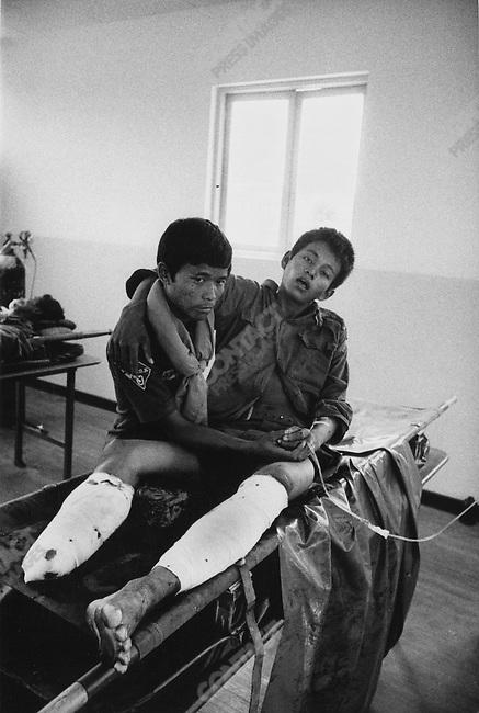 Landmine victim, hospital, Phnom Phen, Cambodia, 1975.
