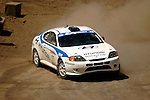 Driver Paul Choiniere and co-driver Jeff Becker come around a turn near the finish line while competing in the Rally Car Race finals during X-Games 12 in Los Angeles, California on August 5, 2006.