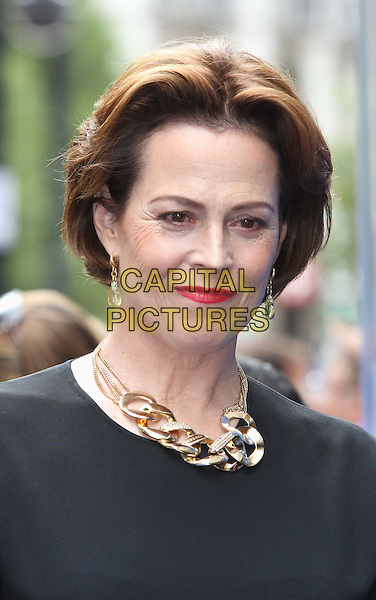 "SIGOURNEY WEAVER .UK Premiere of ""Wall-E"" at the Empire, Leicester Square, London, England..July 13th, 2008.headshot portrait black gold necklace red lipstick earrings .CAP/ROS.©Steve Ross/Capital Pictures."