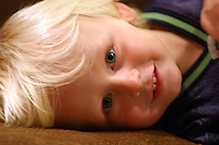 A relaxed portrait of a young boy.