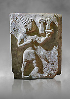 Hittite orthostat relief depicting a god. Hittie Period 1450 - 1200 BC. Hattusa Boğazkale. Hattusa Boğazkale. Çorum Archaeological Museum, Corum, Turkey. Çorum Archaeological Museum, Corum, Turkey. Against a grey bacground.