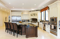 SAN DIEGO, CA - JUNE 1, 2016 - | The kitchen with a 12 foot island in a 12,400 square foot Grand Mediterranean Villa style home by architect Mark Lyon in the La Jolla Farms area.  | (Photo by K.C. Alfred/The San Diego Union-Tribune) . . . .