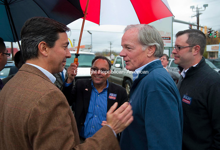 WATERBURY, CT-110114JS02-  Republican candidate for Governor Tom Foley, right, is greeted by former Puerto Rican Gov. Luis Fortuno, left, during his visit to Tequila's Restaurant in Waterbury on Saturday afternoon. <br />   Jim Shannon Republican-American