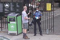 JUL 07 NYPD Hands Out Face Masks in NYC