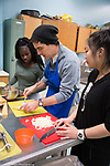 MIHS after school enrichment cooking class taught by voluteer chef