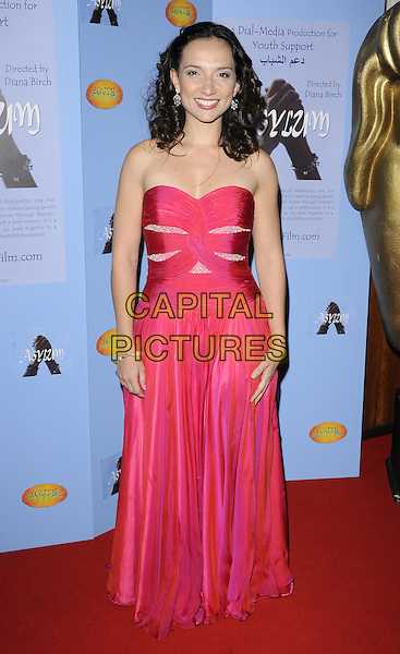 LEILA BIRCH .VIP screening of 'Asylum' at BAFTA, Piccadilly, London, England, UK,.April 21st 2010. .film premiere arrivals full length strapless red pink dress long maxi.CAP/CAN.©Can Nguyen/Capital Pictures.